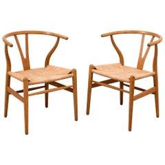 Pair of Early Hans Wegner Wishbone Chairs, Model CH24, 1950s
