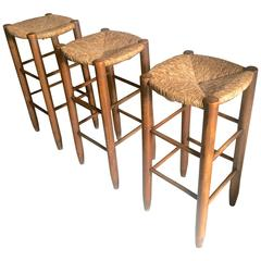 Charlotte Perriand, Set of Three Rush Bar Stools, circa 1950