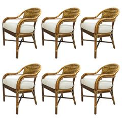 Set of Six Rounded Top Rattan Dining Chairs by McGuire