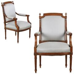 Pair of French Louis XVI Style Carved Walnut Antique Armchairs