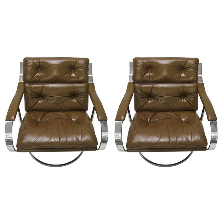Large Lounge Chairs In Original Brown Leather Supported By A Solid Polished Steel Frame That Is