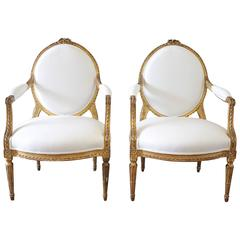20th Century Carved Giltwood Louis XVI Style Open Armchairs