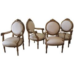 20th Century French Carved Giltwood Open Armchairs