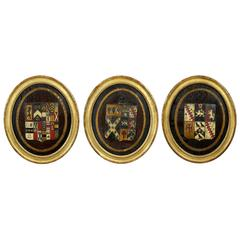 Three British Polychrome Decorated Carved Wood Framed Coats of Arms