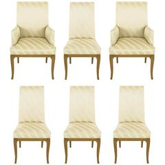 Six Bleached Mahogany and Silk Upholstered Saber Leg Dining Chairs