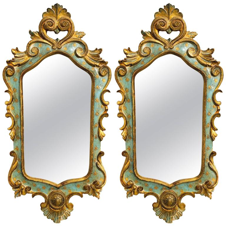 Pair of Italian Painted Carved Wood Mirrors with Brass Caps