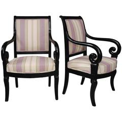 Pair of French 19th Century Empire Period Ebonized Open Armchairs, circa 1820