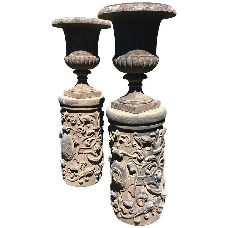 Pair of Tall English Cast Stone Urns on Exceptional Carved Pedestals