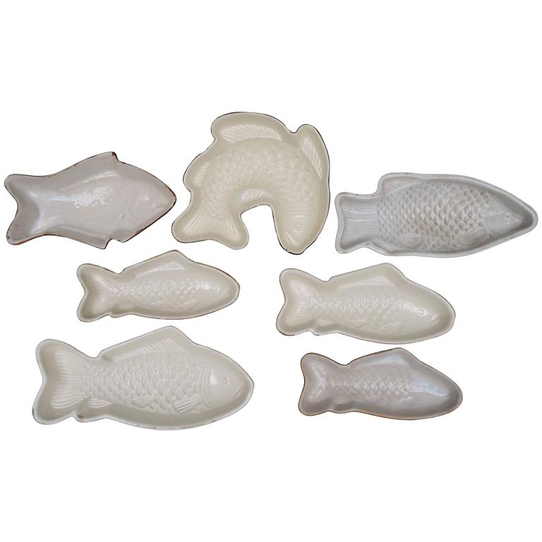 Vintage collection of seven pottery fish shaped dishes for for Fish shaped plates