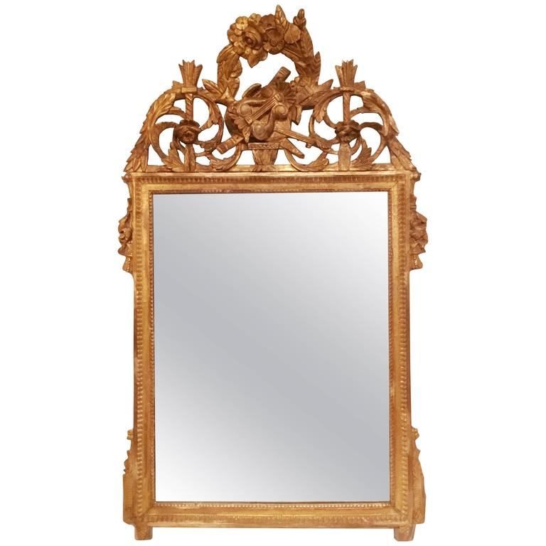 Late 18th Century French Neoclassical Giltwood Mirror Looking Glass with Crown For Sale