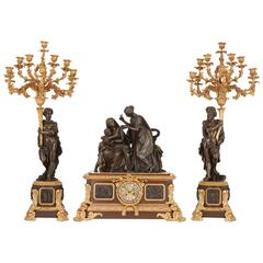 Gilt and patinated bronze antique French clock set