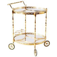 Superb Polished Brass Round Bar Cart Drinks Trolley Attributed to Maison Jansen