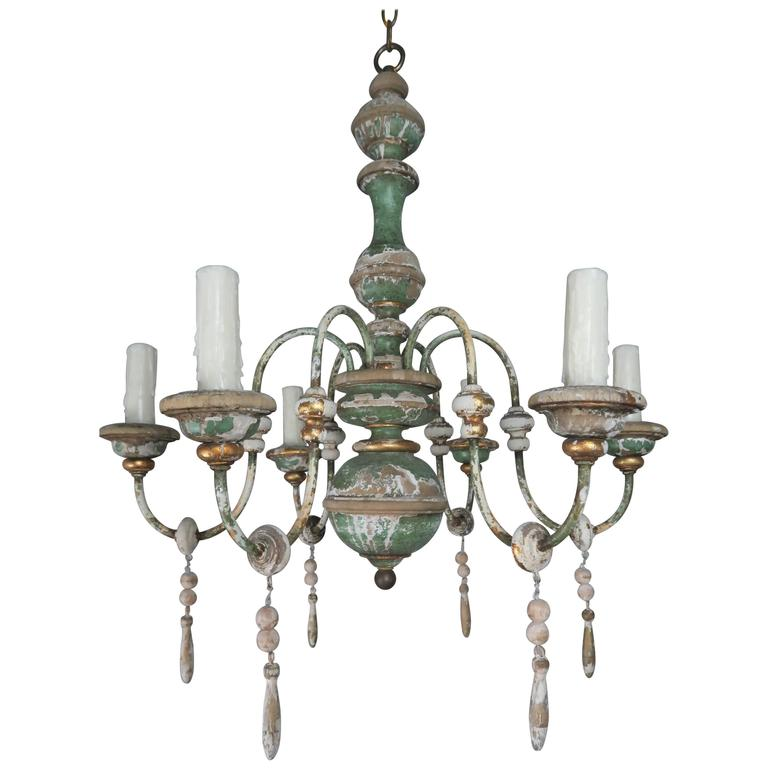 Italian Painted and Parcel-Gilt Chandelier with Wood Drops For Sale