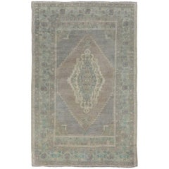 Muted Vintage Oushak Rug from Turkey with Stretched Central Medallion