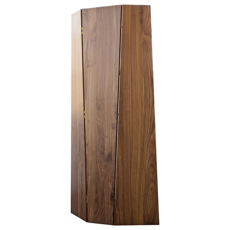 """Sculptural, self-supporting screen for use as a stand-alone or combined to create a larger privacy wall. The tri-fold design can be oriented with the form tapering either up or down.   Shown in solid walnut and bronze.  Dimensions: 78"""" height x 42"""""""