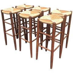Rare Set of Six Rush Bar Stools in the Style of Charlotte Perriand