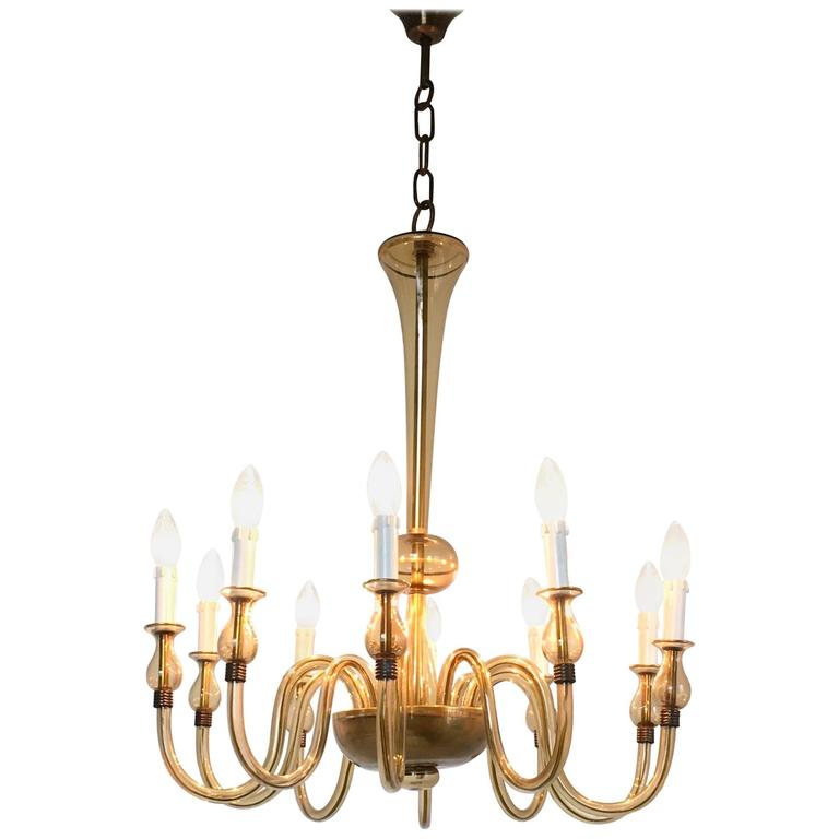 This chandelier is made of blown Murano glass and was produced in Italy in the 1940s. In perfect original condition.