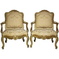 Pair of Italian 19th Century Rococo Style Giltwood Carved Armchairs, circa 1860