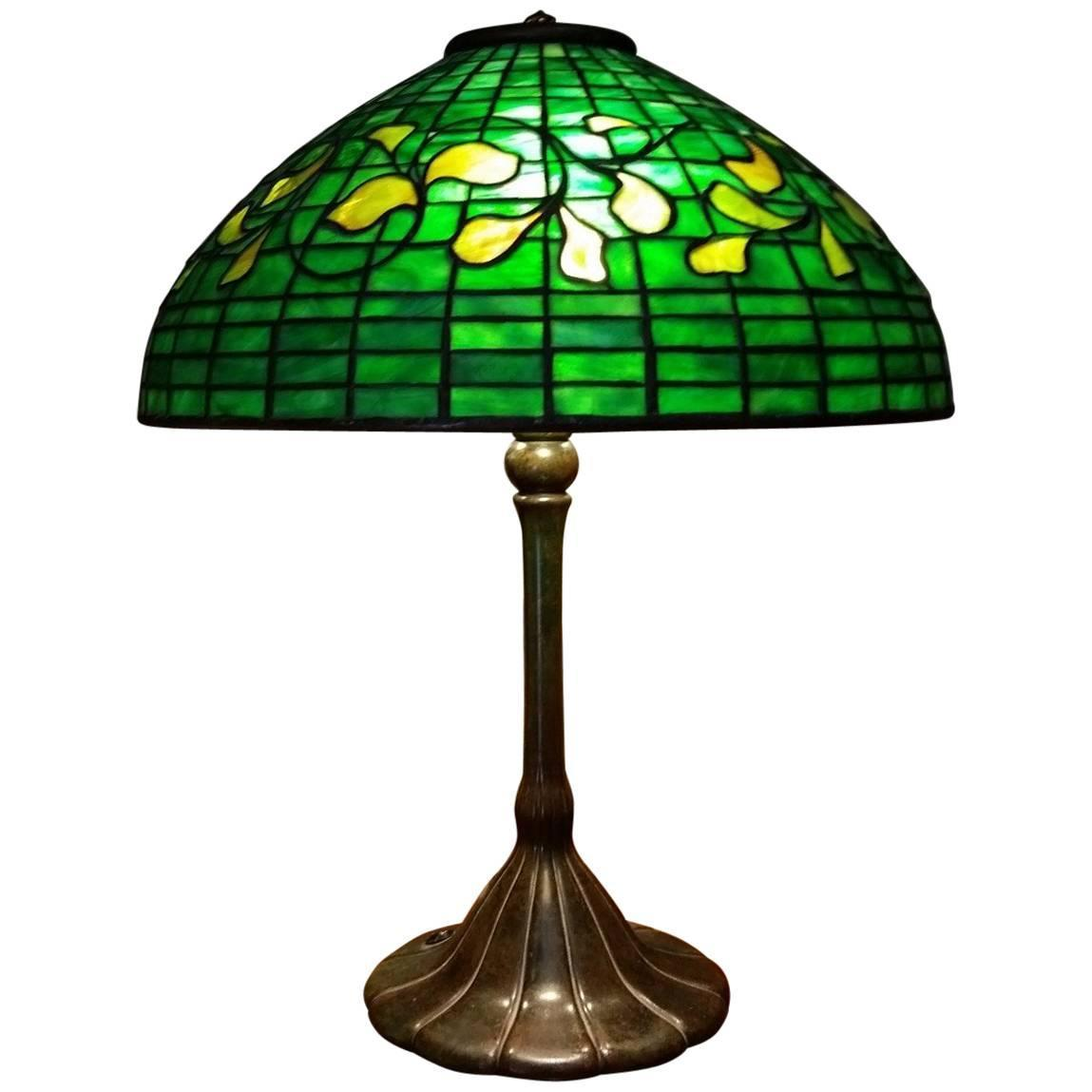 Rare Tiffany Table Lamp In Swirling Leaf Pattern