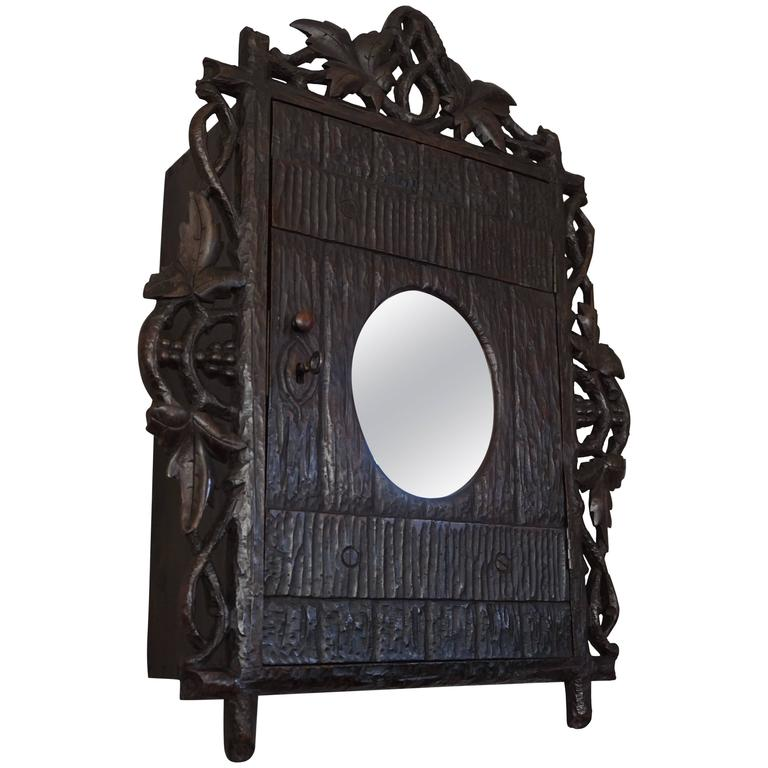 Antique and Hand-Carved Black Forest Medicine Wall Cabinet with Oval Mirror