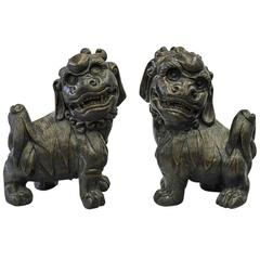Pair of Chinese Gilt Caststone Garden Fu Lions
