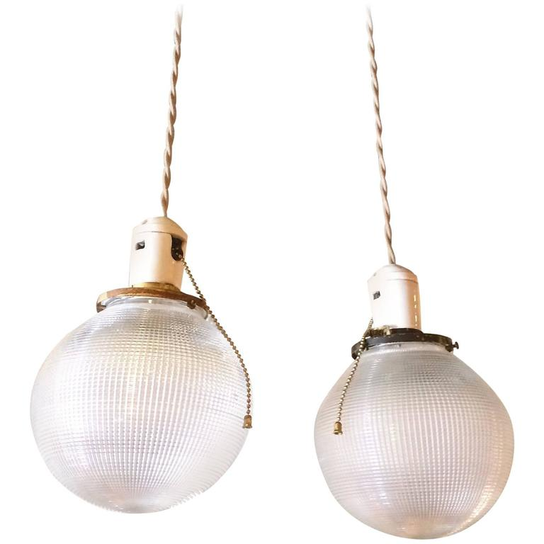 Pair of Industrial Holophane Glass Globe Pendant Lights