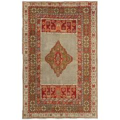 Antique Turkish Oushak Carpet with Colorful Central Medallion Design and Borders