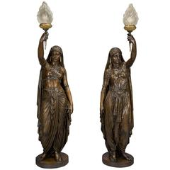 Pair of Patinated Bronze Figural Torcheres Cast by Barbedienne. French, 1872