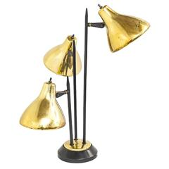 1950s Gerald Thurston Adjustable Brass and Black Table Lamp for Lightolier