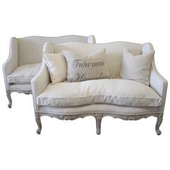 Pair of French Painted and Upholstered Louis XV Style Loveseats
