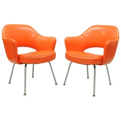 Pair of Eero Saarinen for Knoll Executive Arm Chairs Early Original Orange Vinyl