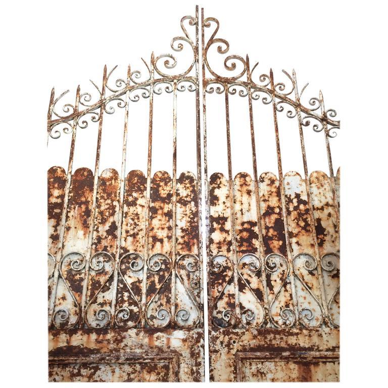 Monumental Pair of Distressed Iron Palace Garden Gates