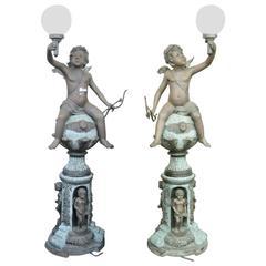 Companion Pair of Bronze Cherub Light Posts
