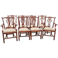 Eight Carved Upholstered Dining Chairs