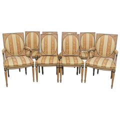 Eight Directoire Style Carved Dining Chairs