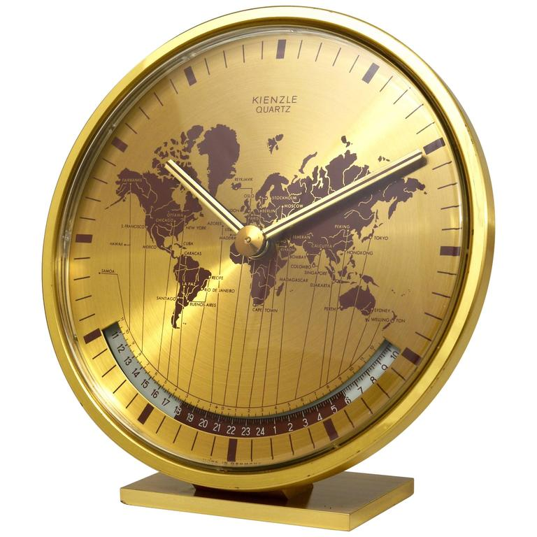 Merveilleux Mid Century Kienzle GMT World Time Zone Brass Table Clock, Germany, 1960s  For