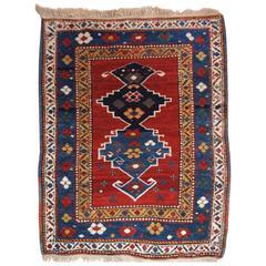 Antique Caucasian Kazak Rug with Linked Medallion Design