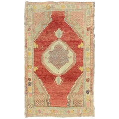 Vintage Turkish Oushak Carpet with Paisley-Shaped Medallion and Four Cornices
