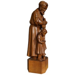 Impressive Hand-Carved Mourning Father and Daughter Sculpture of Afromosia Wood