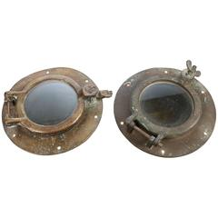 Two, unmatched Solid Brass Boat Porthole