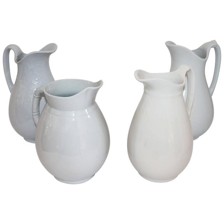 Collection of Four 19th Century Iron Stone Pitchers