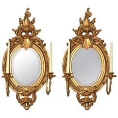 Stunning Pair of Ornate Oval Italian Gilded Mirrors