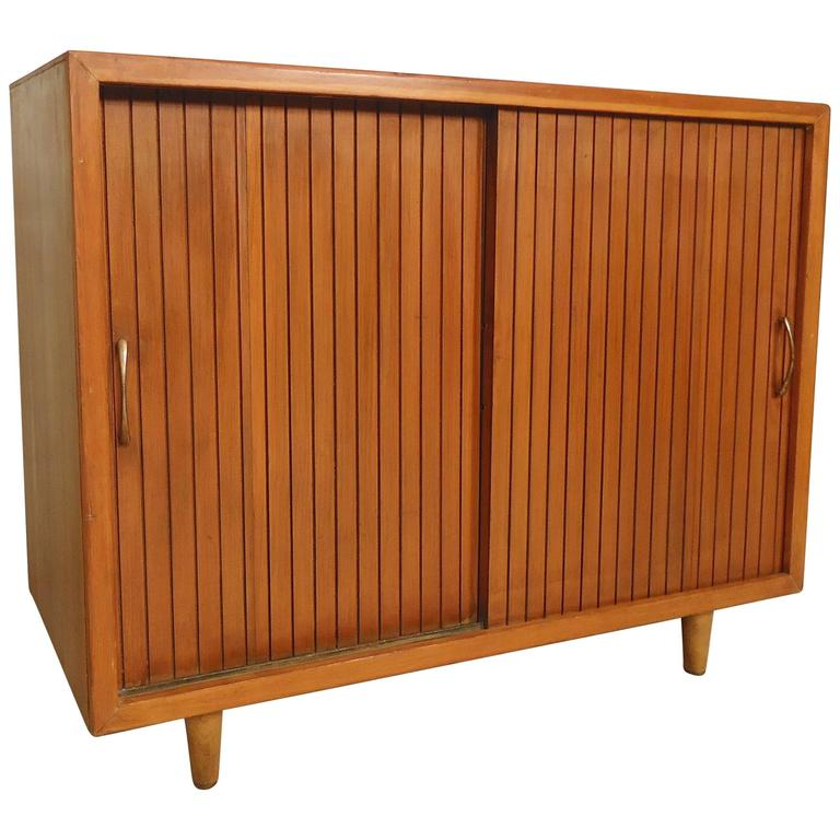 Charming Mid Century Modern Sliding Door Cabinet For Sale
