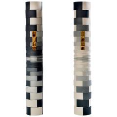 Contemporary Study of One Grey Showing Two Faces Colored Porcelain Columns