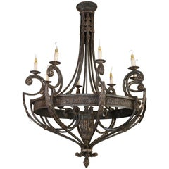 Pair ofLarge  Iron Chandeliers  accented with pale gilt highlights