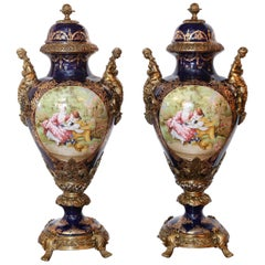 Pair of Large Porcelain Lidded Urns, Bronze Mounted and Gilt Decorated