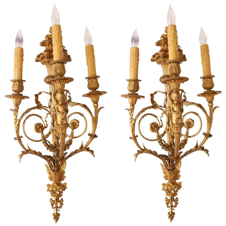 Pair of 19th Century French Neoclassic Gilt Bronze Sconces, Three Lights, Wired