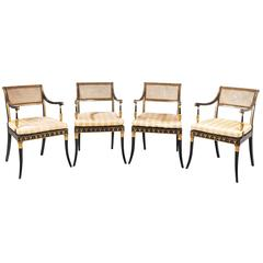 Set of Four Regency Period Lacquered and Parcel Gilt Elbow Chairs