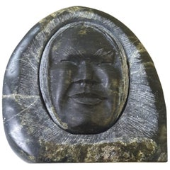 Inuit Soapstone Sculpture of a Face Wrapped in a Parka Hood