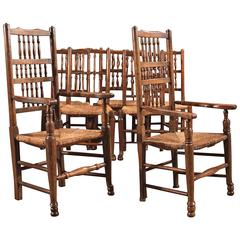 Harlequin Set of Seven Antique Spindle Back Dining Chairs, circa 1800